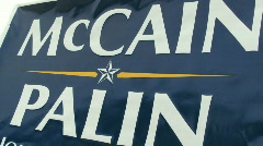 McCain and Palin sign on the street - stock footage