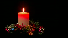 Holiday candle centerpiece with Christmas decorations Stock Footage