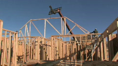 Install roof truss crane lift new home constructionM HD - stock footage