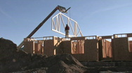 Construction roof truss crane lift on new home M HD Stock Footage