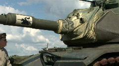 Vfw veteran next to an army tank Stock Footage