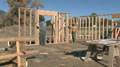 Home construction carpenters building M HD Stock Footage