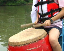 Dragon boat racers set off Stock Footage