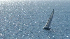 Sailboat in regatta on blue sea Stock Footage