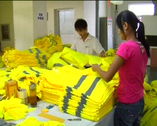 Factory workers sewing jackets Stock Footage
