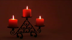 Three candles on a black candelabra - stock footage