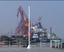 Timber truck exiting ferry in China Stock Footage
