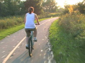 Stock Video Footage of Woman on Bike Ride 1