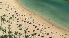 Vacationers on Waikiki Beach in Honolulu, Oahu, Hawaii - view from above Stock Footage
