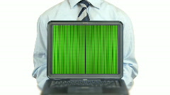 Businessman holding a laptop with opening theater green curtains Stock Footage