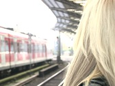 HD1080i Woman talking on cell phone. Train Station. Stock Footage
