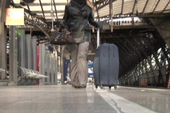 Stock Video Footage of Young woman with suitcases waits for a train