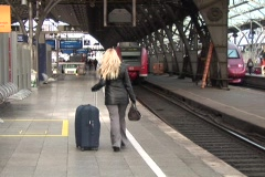 Young woman with suitcases Stock Footage