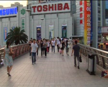 Pedestrians on streets of Shanghai Stock Footage