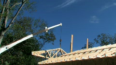 Aerial crane hoisting roof joist into place Stock Footage