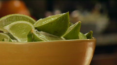 Bowl of sliced limes Stock Footage