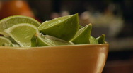 Stock Video Footage of bowl of sliced limes