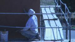 Stucco crew at work on building walls Stock Footage