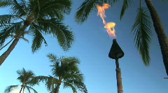 Tiki Torch on Waikiki Beach in Honolulu, Hawaii at sunset Stock Footage