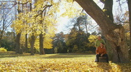 Senior couple in park in autumn Stock Footage