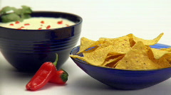 dipping a corn chip - stock footage