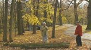 Pensioner balancing on treetrunk Stock Footage