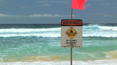 Warning Strong Current Sign at Sandy Beach in Oahu, Hawaii Stock Footage