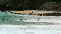 Beachgoers Swimming at Sandy Beach in Oahu, Hawaii Stock Footage