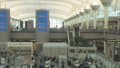 Airport passengers move through security Stock Footage