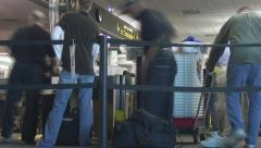 Timelapse passengers move through airport security Stock Footage
