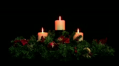 Holiday centerpiece with three white candles Stock Footage