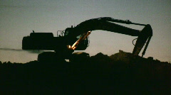 Excavator working at night - stock footage