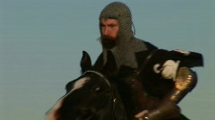 Middle Ages Knight with long sword on horse (Slow Motion) - stock footage