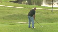 Golfer Tees Off 1 - stock footage