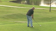Stock Video Footage of Golfer Tees Off 1