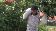 Cambodia: Delivering Rice to poor family - stock footage