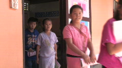 Thailand: Students come out of classroom Stock Footage
