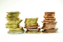 Stock Video Footage of Three stacks of euro coins piling up (Stop Motion)