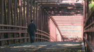 Man Walking on Bridge Stock Footage