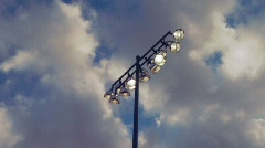 Athletic field lights against clouds Stock Footage