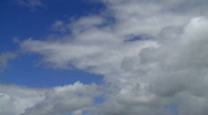 Stock Video Footage of Cloudscape - Fluffy White Rain Clouds Gathering in Blue Sky