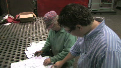 Reviewing Blueprints in Factory 2 - stock footage