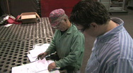 Reviewing Blueprints in Factory 2 Stock Footage