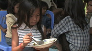 Stock Video Footage of Cambodia: Girl eats rice