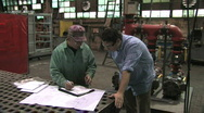 Signing Document in Factory Stock Footage