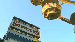 Souvenir Stand at Carnival as Ferris Wheel Spins - stock footage