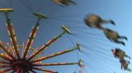 Amusement park carnival swing ride Stock Footage