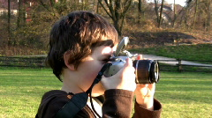 Young boy taking photos with DSLR - stock footage