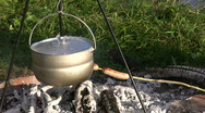 Stock Video Footage of Cooking sausages in a campfire 2