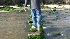 Walking over stepping stones. Stock Footage